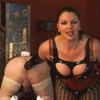 Milf domina fists her male slave anally