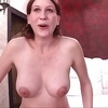 Busty horny redhead cums hard while riding the sybian