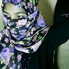 Hijab wearing girl fingers pussy