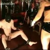 Dominatrix with big tits give dirty slave a handjob and kick