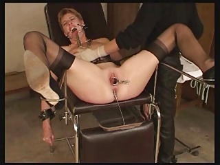 image Ass stretched by speculum and filled with milk