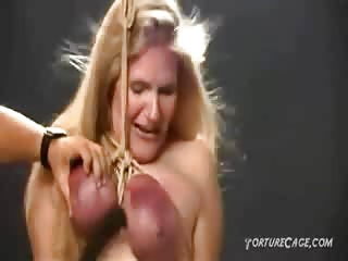 Suspended by her breasts and tortured