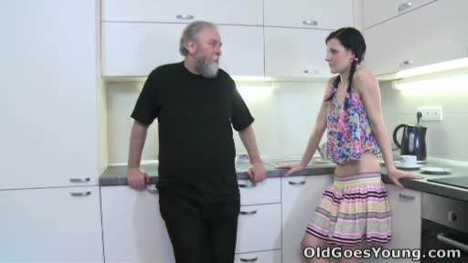 Karina-kneels-before-both-of-her-men-and-takes-their-cum-all-ove