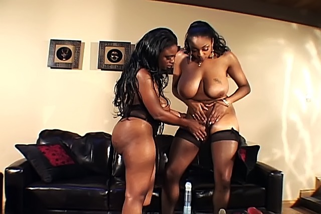 Busty-ebony-chicks-fucking-with-their-pink-dildo