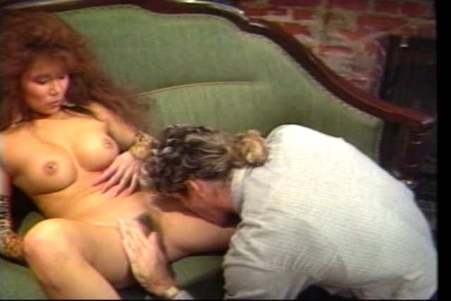 Retro-big-haired-asian-fucks-by-the-fire-place