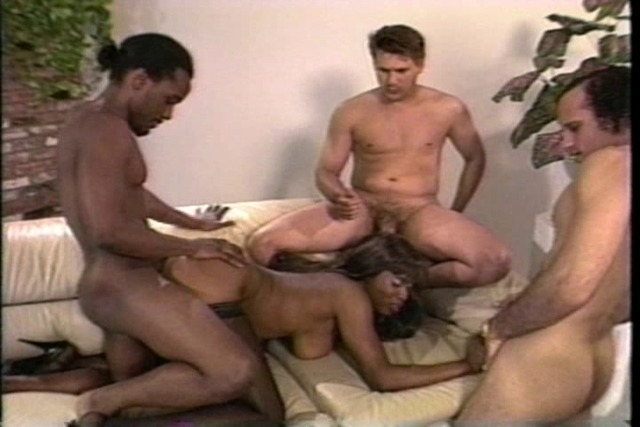Black-girl-rides-one-cock-and-jerks-off-two-more.
