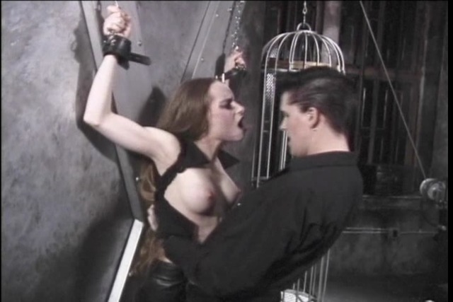 Dark-haired-subbie-in-wrist-restraints-and-nipple-clamps-punishe