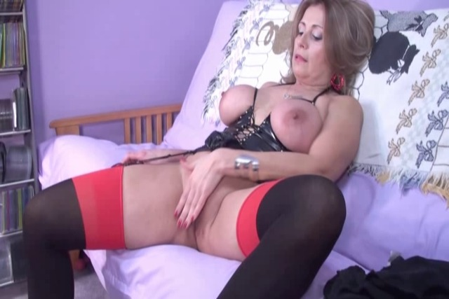 D-cup-MILF-in-corset-and-stockings-fucks-herself-deep-with-dildo