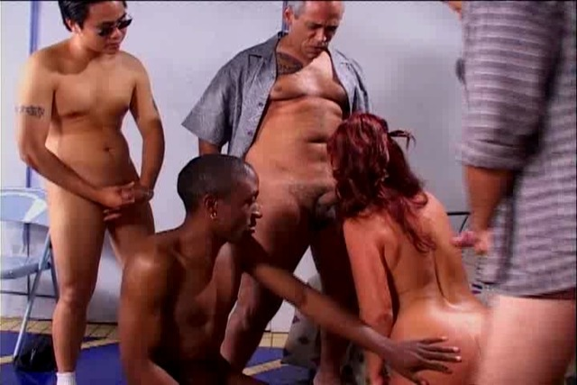 Nasty-lady-takes-on-room-full-of-horny-studs