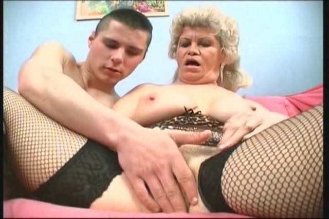 Corset-wearing-grandma-finger-fucked-by-stud
