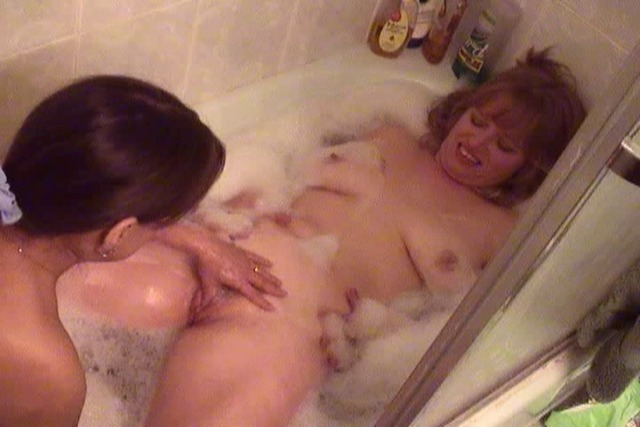 Girl-takes-dildo-and-fucks-blonde-in-the-bathtub
