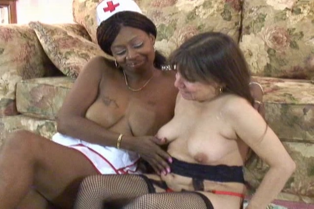 Mature-lesbians-have-steamy-sex-on-the-couch
