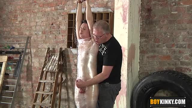 Shaved-twink-getting-wrapped-in-plastic-and-wanked-hard