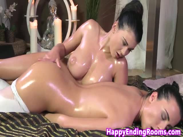 Bigtitted-lesbian-masseuse-rubbing-beauty
