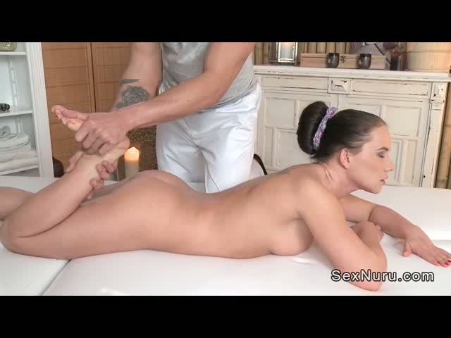 Nude-brunette-gets-massage-and-fuck-on-a-table