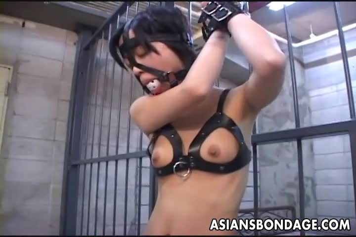 Asian-bitch-roped-up-and-given-water-to-drink