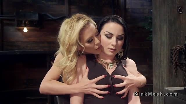 Busty blonde gives anal strap on fuck to brunette