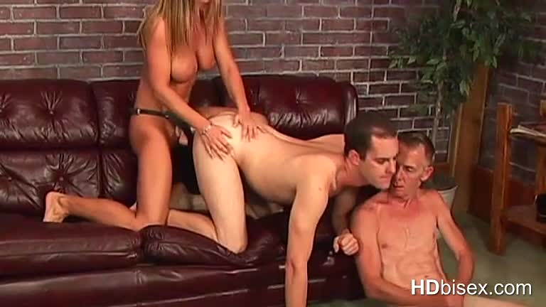 Busty-chick-fucks-guy-with-strap-on