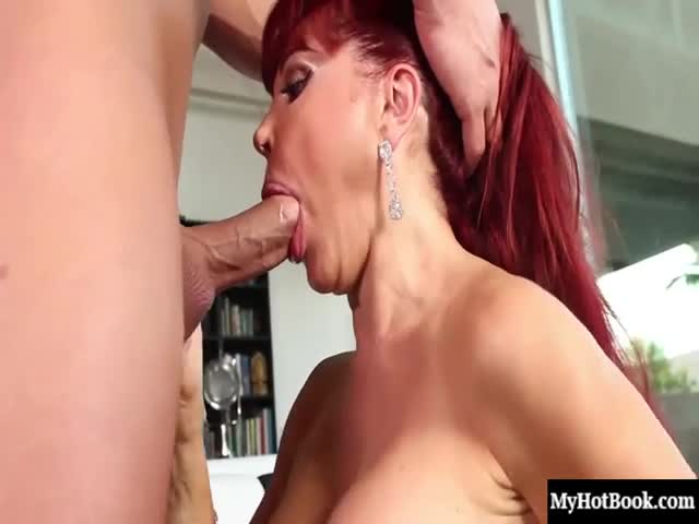 Sexy-Vanessa-is-a-mature-redhead-with-giant-round-tits-and-a-wet