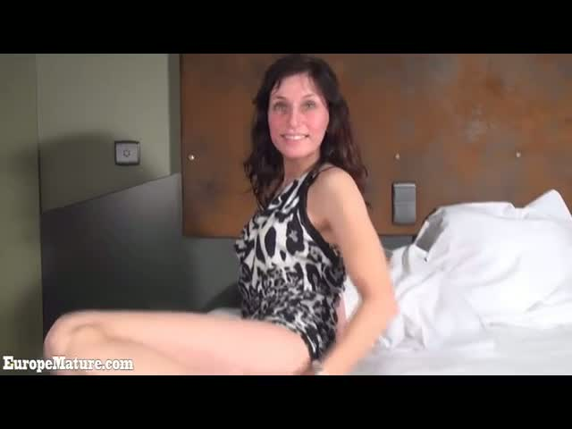Sexy-Mom-does-striptease-in-the-bed-in-striped-clothes