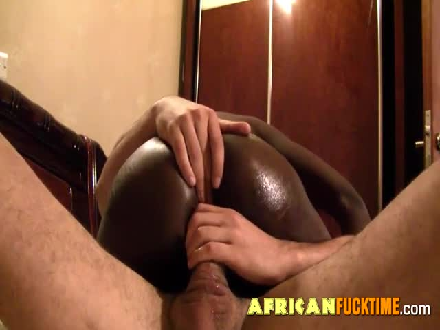 Ebony-bitch-rides-a-white-dick