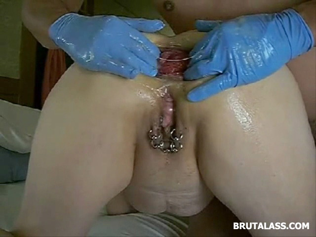 Pierced-Woman-Gets-Her-Asshole-Fisted-By-A-Blue-Glove