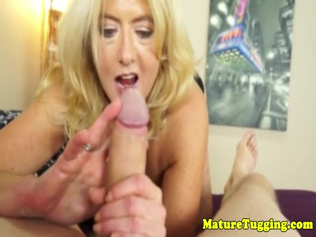 Bigtitted-mature-gives-handjob-for-cumshot-pov