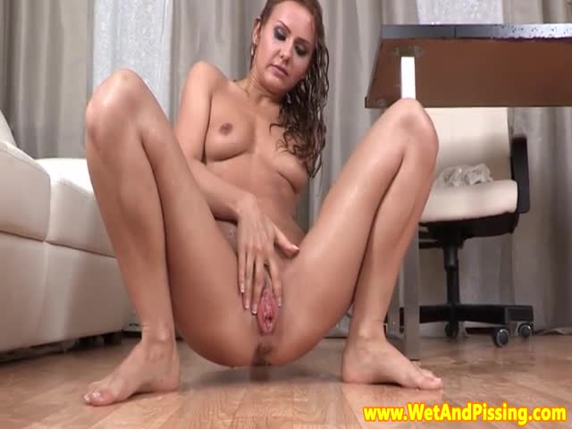 Urine-fetish-babe-splashing-around-in-her-pee