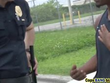 Black dude banging two busty cops