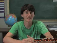 Gay young cub porn movie Jeremy Sommers is seated at a desk and an