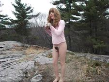 Sissy slut plays with her tiny clitty dick in the woods